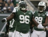 The New Blood: Quinton Coples looks on as Mo WIlkerson celebrates a sack.