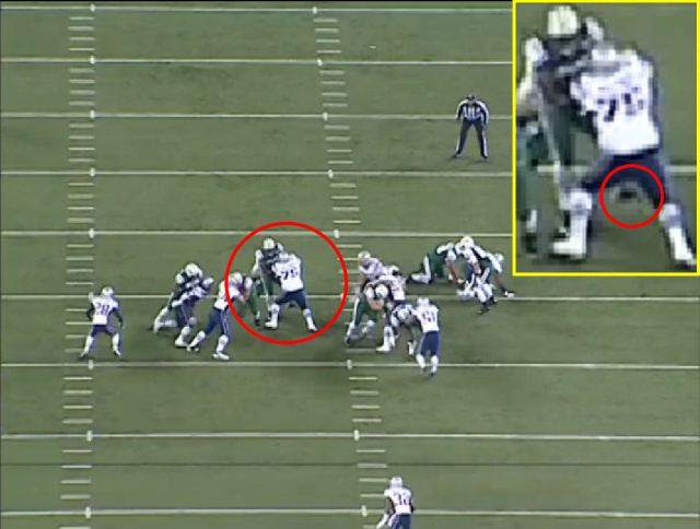 Picture 5: Wilfork has lifted Moore to the point where his left foot is off the ground.