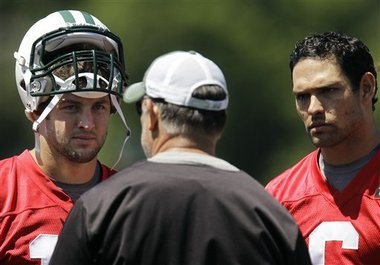Sanchez and Tebow at work in the 2012 offseason.